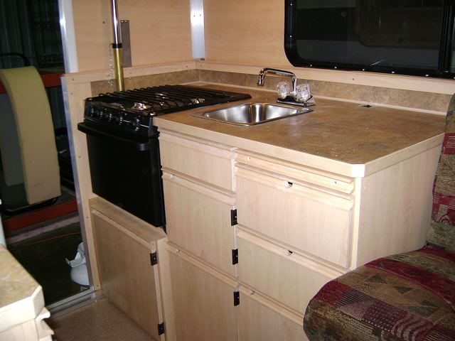 Camper trailer cabinets cool yellow camper trailer for Camper kitchen cabinets